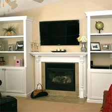 built in bookcasebuilt shelving units around tv and fireplace