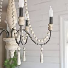 rustic farmhouse chandelier in the dining room katienisbett on my pretty dining room lighting was found the details of this chandelier are beautiful