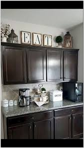top of the kitchen cabinet decor rustic farmhouse decor above kitchen cabinets decoomo