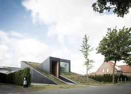 sloped green roof covers split level home
