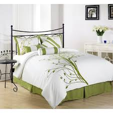 black steel bed with white and lime green bedding set placed in