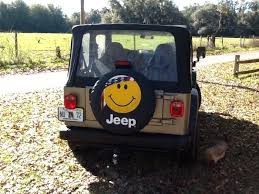 tire cover jeep wrangler jeep smiley tire cover justforjeeps com smilecover