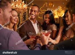 cocktail party group friends drinks enjoying cocktail party stock photo 623150357