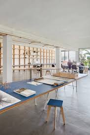 designers architects barcelona warehouse transformed into flexible co working space for