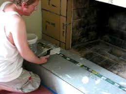 How To Lay Brick Fireplace by Laying Tile On Fireplace Youtube