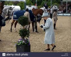 land rover queens queen elizabeth ii present the trophy to the winners of the land
