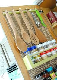 kitchen organization ideas for storage on the inside of the i like the idea of hanging measuring cups and spoons in the cabinet doors easily accessible instead of digging through a drawer kitchen organization