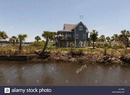 houses sitting on stilts pilings in crystal river florida stock