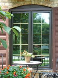 dining room pella windows with blinds and round table plus