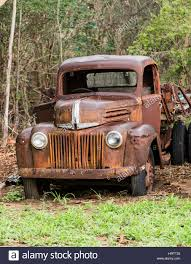 Classic Ford Truck Bumpers - old abandoned rusty ford truck in field stock photo royalty free