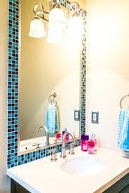 Bathroom Mirror Frames by Tile Frame Around Mirror I Would Use A Chair Rail And Stain It To