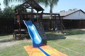 Backyard Slip N Slide How To Create The Ultimate Backyard Water Park On The Cheap Daddledo