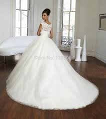 turmec lace ball gown wedding dress with cap sleeves