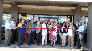 farmers home furniture chamber of commerce held a ribbon cutting
