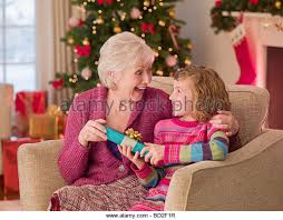 gifts for elderly grandmother giving present christmas elderly stock photos giving present