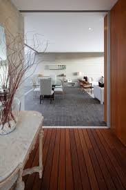 luxurious dining room with stone tile floor combined with timber