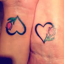 tattoo art and style matching mother daughter tattoo