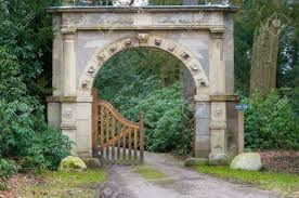 ancient looking stone arch gate decorated with zodiac signs stock