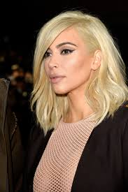 a side part with long hair and a swoop and a cross kim kardashian long side part lookbook stylebistro