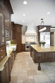 simple cream color natural stone tile kitchen floor with running