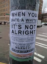 did an antifascist group put up anti white posters in seattle