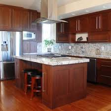 used kitchen islands cherry wood cabinets with white granite counters and white island