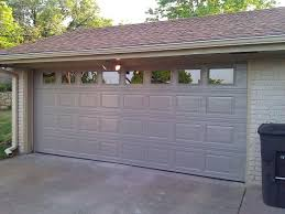 garage door conversion exterior with architectural elements