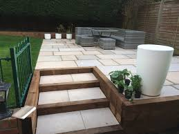 Raised Patio Pavers by Raised Patio Area With Incorporated Steps Within Timber Frame