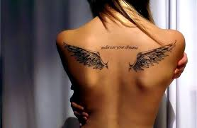small wing shaped design on back tattoomagz