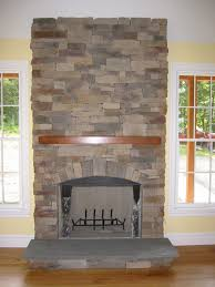 natural stone fireplace manufactured stone fireplaces offer a cheaper alternative to real stone