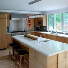 maple cabinets with white countertops love these thick and shiny stainless steel countertops kimball s