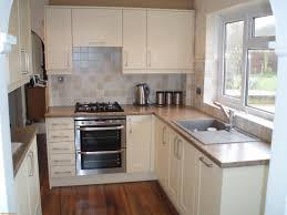kitchen room kitchen island with stove top tall oven and