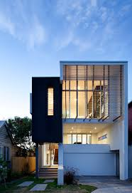 modern tropical house on a small lot with a garden archian designs