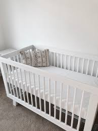 hudson convertible crib white and cream nursery faux bois wallpaper white crib and pouf