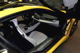 yellow porsche twilight bmw i8 in abu dhabi painted in lava yellow drivers magazine