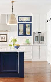 white kitchen cabinets with blue island color is a moment a bold blue island white cabinets