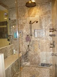 interesting shower faucet above brown tile flooring inside