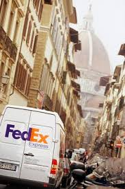 loading up fedex express delivery vehicles