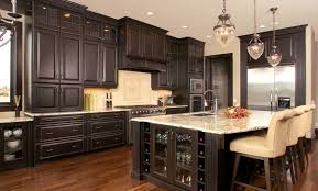 marble countertops black distressed kitchen cabinets lighting