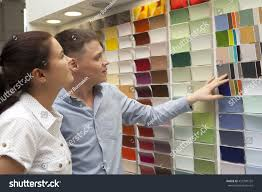 happy couple family select paint color stock photo 435799732