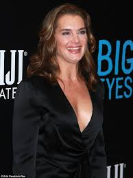Black Blouse With White Collar Brooke Shields Wears Silky Black Blouse With Very Plunging