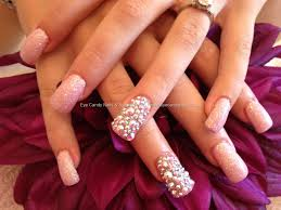acrylic nails with glitter dust and full swarovski crystals on