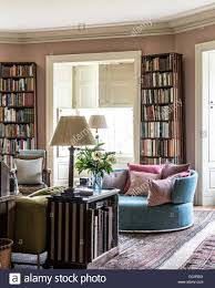 b u0026b italia sofa in library with book cases designed by tom helme