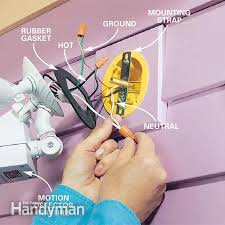 replacing outdoor light fixture how to choose and install motion detector lighting the family handyman