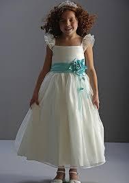 ivory tea length dress with ruffle sleeve