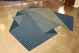 design a rug that resembles a folded sheet of paper