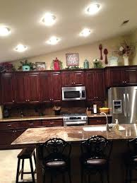 kitchen cabinets top decorating ideas top of cabinet decor ideas musicyou co