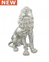 silver lion statue facing silver lion statue