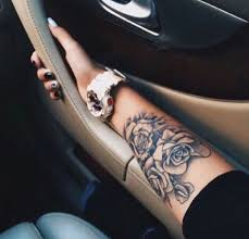 black and white forearm tattoo a cluster of three roses
