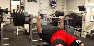 strongman eddie hall bench presses 584 pounds for 6 reps barbend